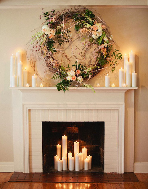 Abbellire il camino con le candele